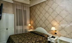Letto o letti in una camera di Palazzo Riario