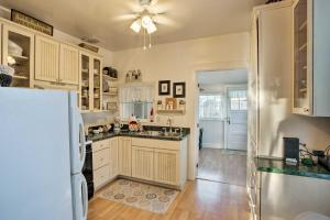 A kitchen or kitchenette at Serendipity Cottage with Yard, Walk to Town and Dining!