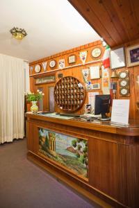 Лобби или стойка регистрации в Hotel Moderno