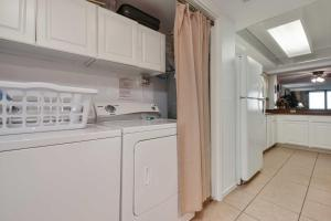 A kitchen or kitchenette at Beachfront Port Aransas Condo with Pool Access!