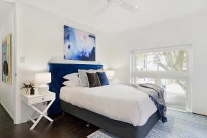 A bed or beds in a room at Large Converted Church Apartment In Top Location