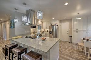 A kitchen or kitchenette at Updated Sacramento Home with Grill, Patio, and Pool!