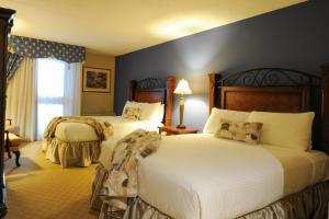 Un ou plusieurs lits dans un hébergement de l'établissement Old Stone Inn Boutique Hotel