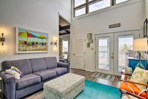 A seating area at Bright Condo with Balcony - Walk to Dewey Beach!