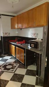 A kitchen or kitchenette at Diyar Al Hamra