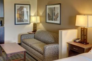 A seating area at Holiday Inn Express Hotel & Suites Huntsville