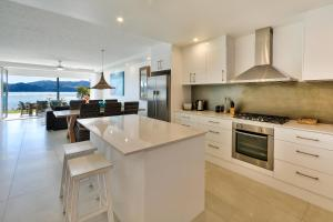 A kitchen or kitchenette at Hamilton Island Holiday Homes