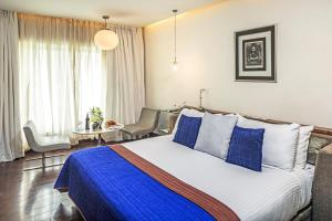 A bed or beds in a room at The Park New Delhi