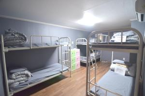 A bunk bed or bunk beds in a room at Kimchee Hongdae Guesthouse
