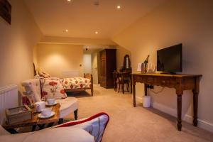 A television and/or entertainment centre at Dene House Farm