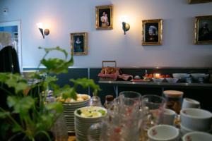 Ein Restaurant oder anderes Speiselokal in der Unterkunft Hotel La Bohème