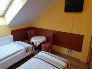 Łóżko lub łóżka w pokoju w obiekcie Gościniec Słoneczny