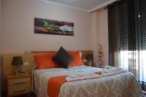 Cama o camas de una habitación en Hostal Carrizo
