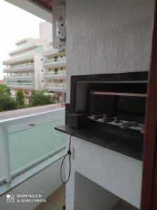 A television and/or entertainment centre at RESIDENCIAL ARARA AZUL