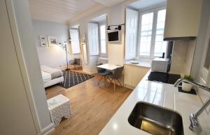 A kitchen or kitchenette at Sophia Residences