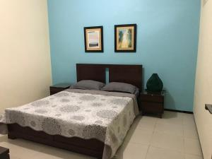 A bed or beds in a room at Sudji's House