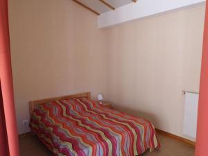 Un ou plusieurs lits dans un hébergement de l'établissement Les Gîtes du Val