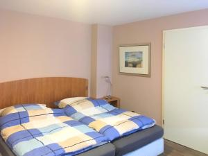 Ein Bett oder Betten in einem Zimmer der Unterkunft Jachabauer