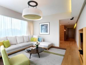 A seating area at Lanson Place Bukit Ceylon Serviced Residences