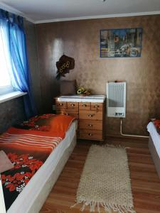 Posteľ alebo postele v izbe v ubytovaní Chata ALBA REGIA