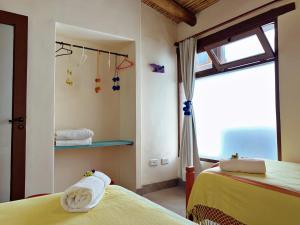 Una cama o camas en una habitación de Las Vicuñas Departamentos