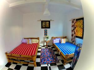 A bed or beds in a room at Villa 25 COCO Beach House Masasa Beach Batangas