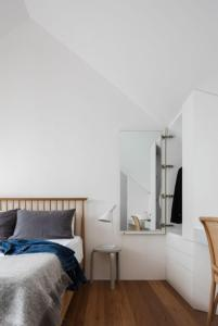 A bed or beds in a room at Architectural Design Award winning city House