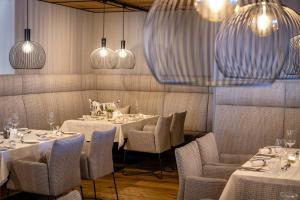 Ein Restaurant oder anderes Speiselokal in der Unterkunft Hotel das Zwölferhaus