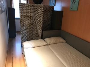 A bed or beds in a room at Host Bell Rooms&Suites