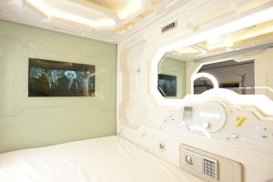 A bed or beds in a room at The Yellow Capsule Tour Inclusive Experience
