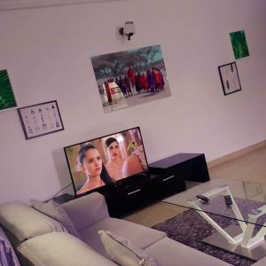 A television and/or entertainment center at New Land Sarl