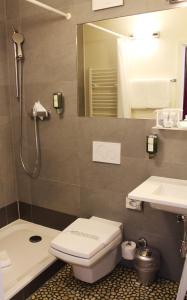 Ein Badezimmer in der Unterkunft Hôtel des Inventions
