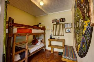 A bunk bed or bunk beds in a room at Amphitheatre Backpackers Lodge