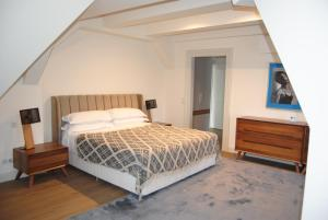 A bed or beds in a room at Úttö Luxury Suites
