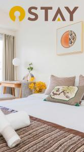 A bed or beds in a room at Ostay Osaka-jo Hotel Apartment
