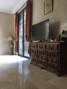 A television and/or entertainment center at villa targa