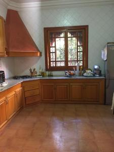 A kitchen or kitchenette at villa targa