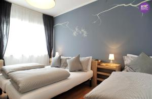 A bed or beds in a room at Stop & Sleep Udine
