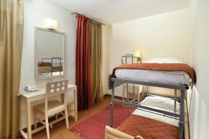 A bunk bed or bunk beds in a room at Villas Kornati