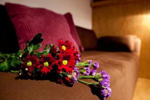 Letto o letti in una camera di Dahlia Inn