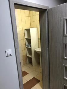 A bathroom at Apartament cztero osobowy Dęblin