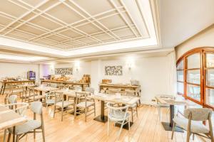 Un restaurante o sitio para comer en Sercotel Arenal Bilbao