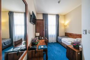 Telewizja i/lub zestaw kina domowego w obiekcie Hotel Piast Wrocław Centrum