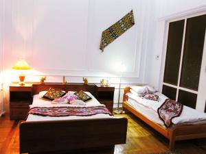 A bed or beds in a room at Bukhara Prestige