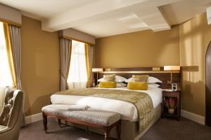 A bed or beds in a room at Trinity Townhouse Hotel