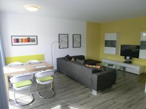 Ein Sitzbereich in der Unterkunft Kleeblatthaus Putbus Rügen