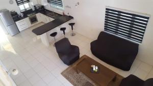 Uma área de estar em Villa Mila
