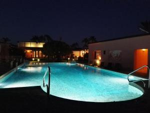 The swimming pool at or near Hotel Eros