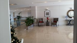 The lobby or reception area at Grand Hotel Apartments Gold Coast by owner