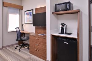 A television and/or entertainment center at Holiday Inn Express New Orleans - St Charles